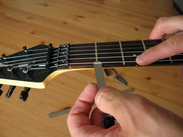 guitare electrique qui frise